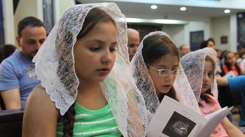 Cristãos iraquianos refugiados na Jordânia rezam pela paz. Foto: Jamal Nasrallah/EPA